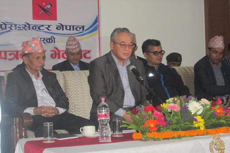 Home Minister Ram Bahadur Thapa speaking at a press meet organised by Kaski chapter of Press Centre Nepal, in Pokhara, on Monday, May 14, 2018. Photo: THT