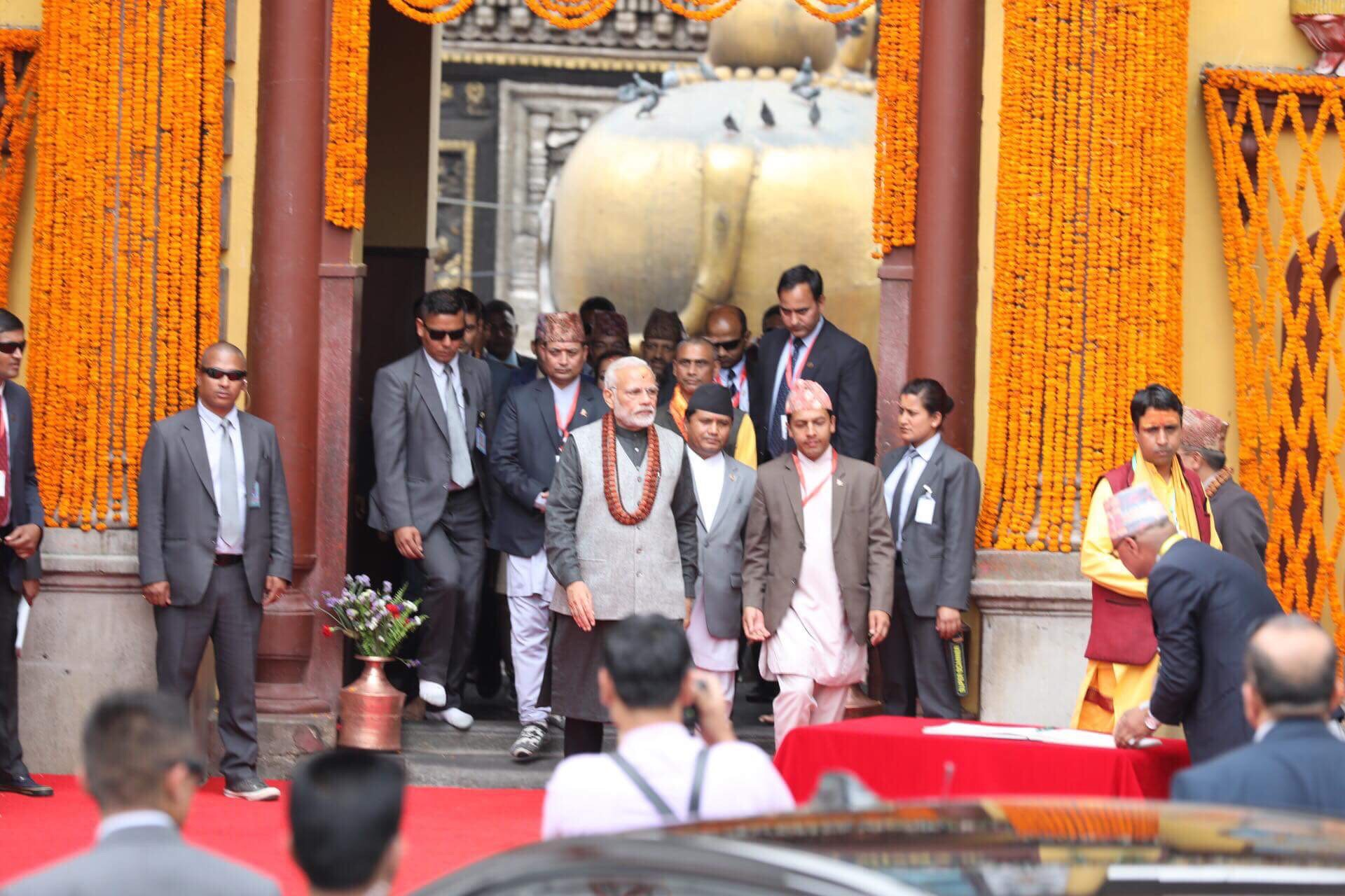 Indian Prime Minister Narendra Modi returning after performing special worship with the u2018Vedic Rudrabhisheku2019, at the main entrance of Pashupatinath temple, in Kathmandu, on Saturday, May 12, 2018. Photo: THT Online