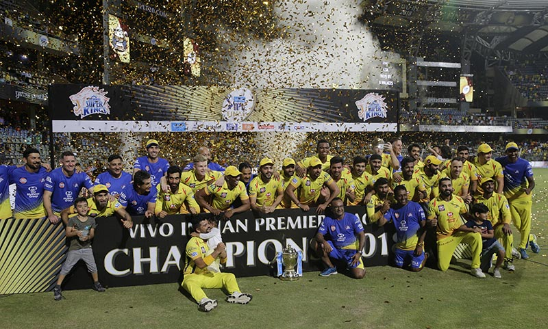 Members of Chennai Super Kings pose with trophy after wining against Sunrisers Hyderabad's at VIVO IPL cricket T20 final match in Mumbai, India, on Sunday, May 27, 2018 . Photo: AP