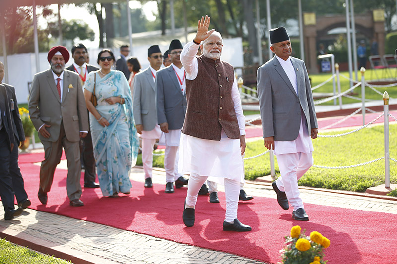 Indian Prime Minister Narendra Modi waves as he walks towards his departure after a two-day official visit at Tribhuvan International Airport in Kathmandu on Saturday. Photo/Skanda Gautam