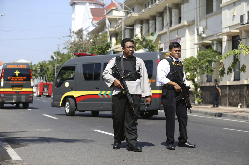 Officers stand guard following an attack at the local police headquarters in Surabaya, East Java, Indonesia, on Monday, May 14, 2018. Photo: Associated Press.