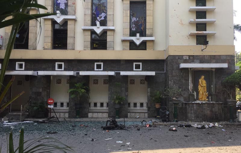 Debris are seen outside Santa Maria church where an explosion went off in Surabaya, East Java, Indonesia, on Sunday, May 13, 2018. Photo: Associated Press
