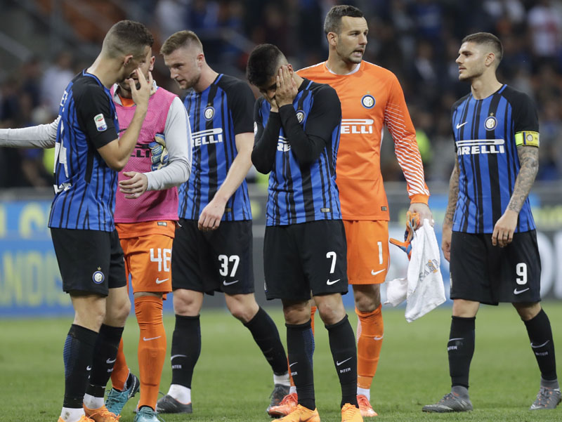Inter Milan players leave the pitch at the end of the Serie A  match between Inter Milan and Sassuolo at the San Siro stadium, Milan, Italy, on Saturday, May 12, 2018. Photo: Associated Press