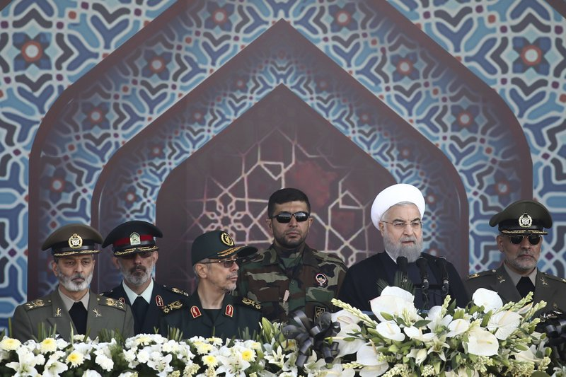 File - In this photo, Iranian President Hassan Rouhani, second right, speaks at a military parade marking the 37th anniversary of Iraqu2019s 1980 invasion of Iran, just outside Tehran, Iran on  Sept. 22, 2017. Photo: AP