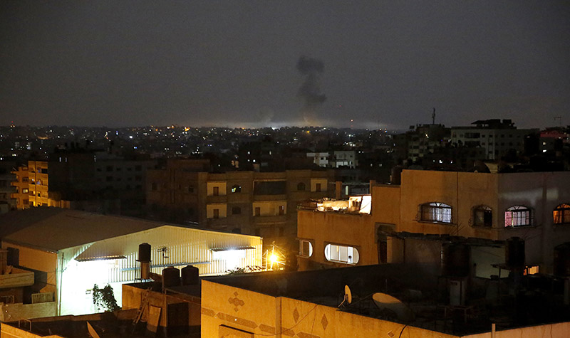 Smoke rises following Israeli strikes on Gaza City, early Wednesday, on May 30, 2018. Palestinian militants bombarded southern Israel with dozens of rockets and mortar shells while Israeli warplanes struck targets throughout the Gaza Strip in the largest flare-up of violence between the sides since a 2014 war. Photo: AP
