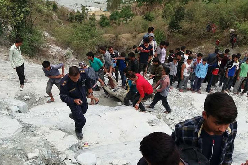 Locals pulling away body from a stream in Bajhang district, on Thursday, May 03, 2018. Photo: Tekendra Deuba