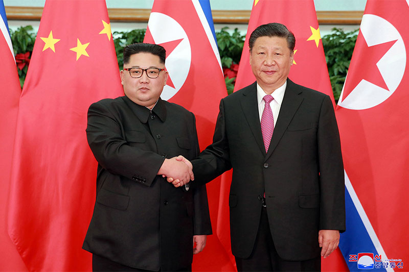 North Korean leader Kim Jong Un, left, meets Chinese President Xi Jinping in Dalian, China.on Tuesday, May 9, 2018. Photo: Associated Press