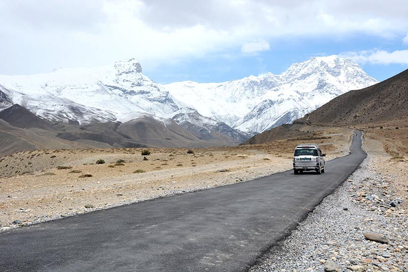 A vehicle carrying pilgrims plies along the newly tarmacked road from Kagbeni to Muktinath, on Friday, May 18, 2018. Photo: RSS