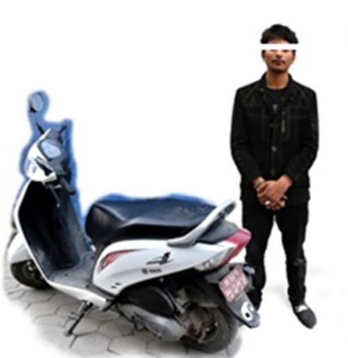 Yashif Sheikh (24) of Jhunkhunuwa in Yamunamai Rural Municipality-5 of Rautahat district, currently residing in Maitidevi, along with the seized scooter being made public in Kathmandu. Photo: Metropolitan Police Crime Division
