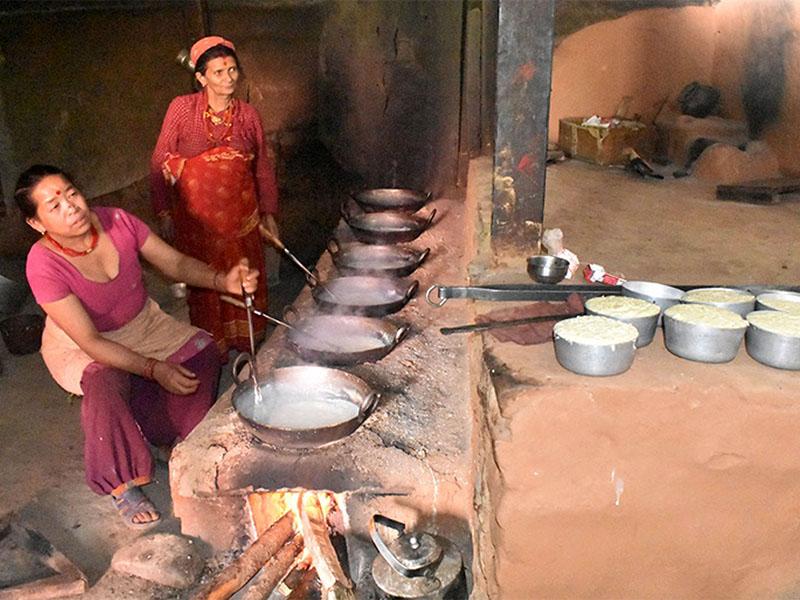Women preparing authentic Nepali Kurauni/Khuwa in Kavre district, on Sunday, May 27, 2018. Photo: RSS