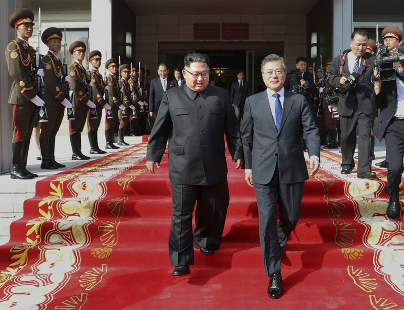 In this photo provided on May 27, 2018 by South Korea Presidential Blue House, North Korean leader Kim Jong Un, center left, and South Korean President Moon Jae-in, right, walk after their meeting at the northern side of Panmunjom in North Korea on  May 26, 2018. Photo: AP