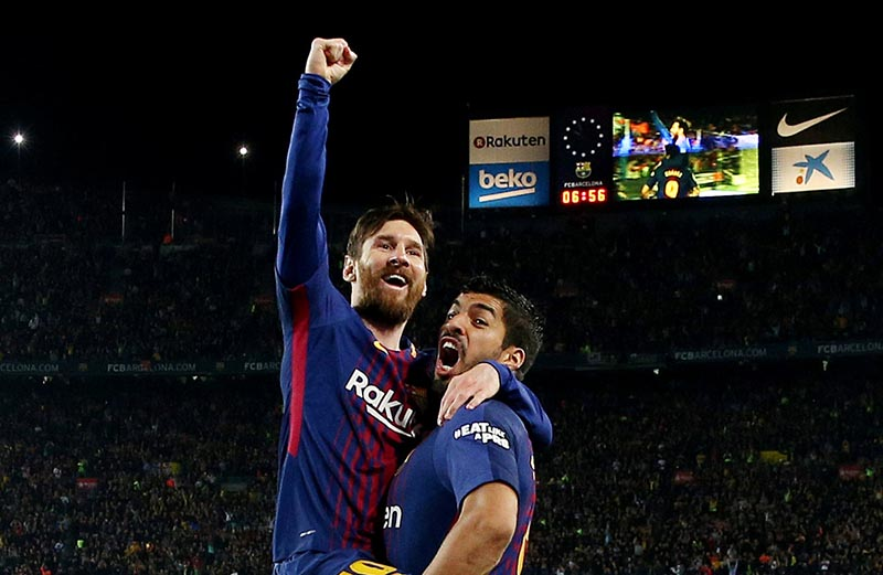 Barcelona's Lionel Messi celebrates scoring their second goal with Luis Suarez during the La Liga Santander match between FC Barcelona and Real Madrid, at Camp Nou, in Barcelona, Spain, on May 6, 2018. Photo: Reuters