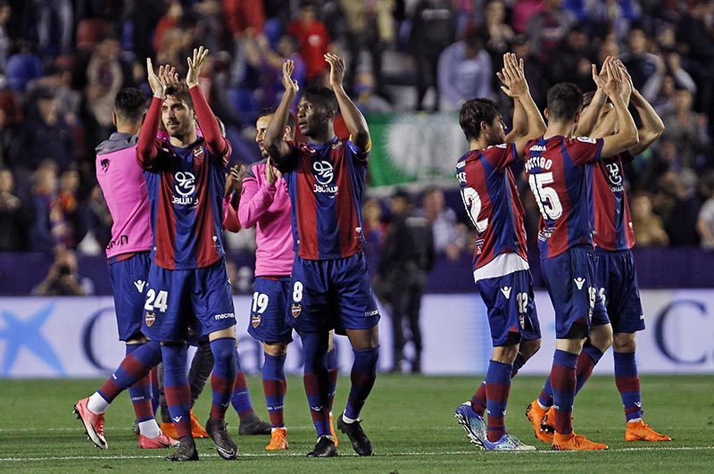 Levante's players celebrates their victory against Barcelona during the Spanish La Liga soccer match between Levante and Barcelona at the Ciutat de Valencia stadium in Valencia, Spain, on Sunday, May 13, 2018. Photo: AP