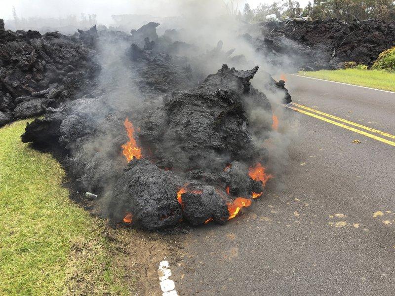 Lava from the Kilauea volcano moves across the road in the Leilani Estates in Pahoa, Hawaii, on Saturday, May 5, 2018. Photo: AP