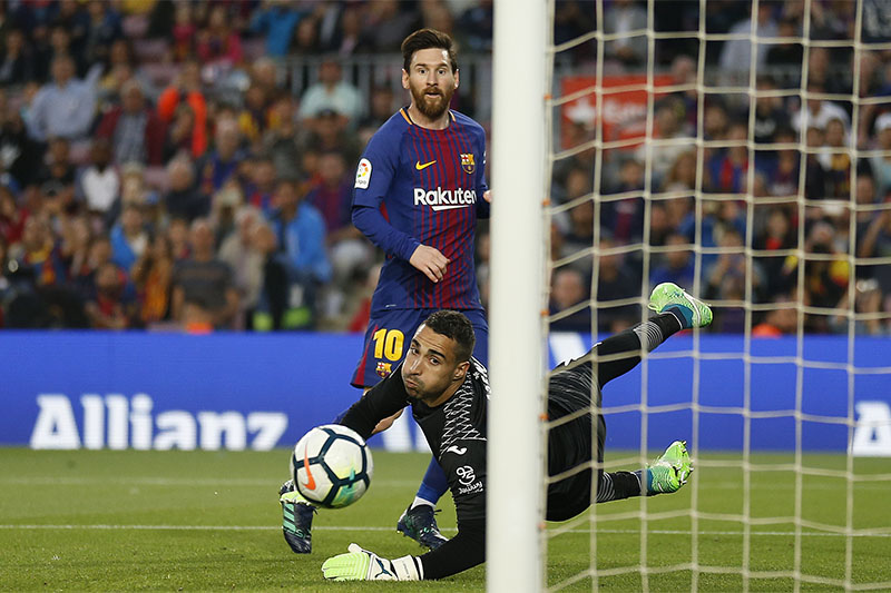 FC Barcelona's Lionel Messi kicks the ball to score during the Spanish La Liga match between FC Barcelona and Villarreal at the Camp Nou stadium in Barcelona, Spain, on Wednesday, May 9, 2018. Photo: Associated Press