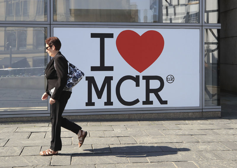 A woman walks past a 'I Love Manchester' sign ahead of the Manchester Arena National Service of Commemoration at Manchester Cathedral, to mark one year since the attack on Manchester Arena, on Tuesday May 22, 2018. Photo: Associated Press