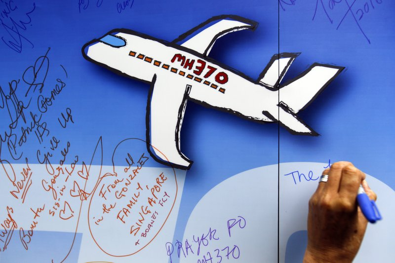 File - In this photo, well wishes are written on a wall of hope during a remembrance event for the ill fated Malaysia Airlines Flight 370 in Kuala Lumpur, Malaysia on  March 6, 2016. Photo: AP