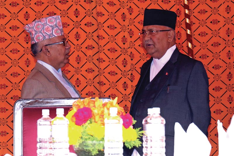 Prime Minister KP Sharma Oli and NCP leader Madhav Kumar Nepal at a tea party at the Presidentu0092s Office, on Monday, May 28, 2018. Photo: THT