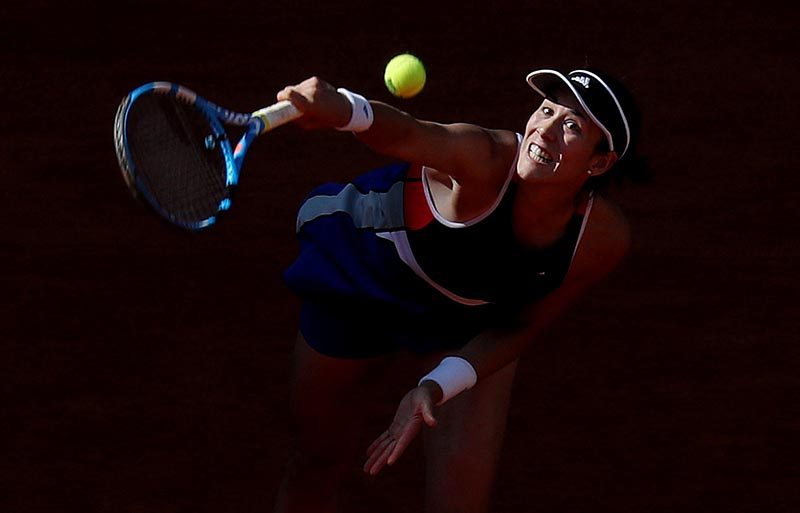 Spain's Garbine Muguruza in action against China's Shuai Peng during their round of 64 match at Madrid Open, in Madrid, Spain, on May 6, 2018. Photo: Reuters