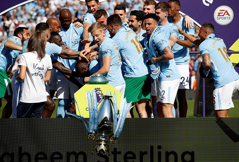 Manchester City's Oleksandr Zinchenko reacts as the trophy falls to the floor as players and staff celebrate winning the premier league title after the Premier League match between Manchester City and Huddersfield Town, at Etihad Stadium, in Manchester, Britain, on May 6, 2018. Photo: Action Images via Reuters