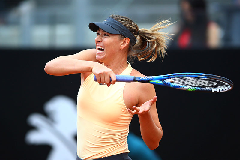 Russia's Maria Sharapova in action during her second round match against Slovakia's Dominika Cibulkova in Italian Open, on Wednesday, May 16, 2018. Photo: Reuters