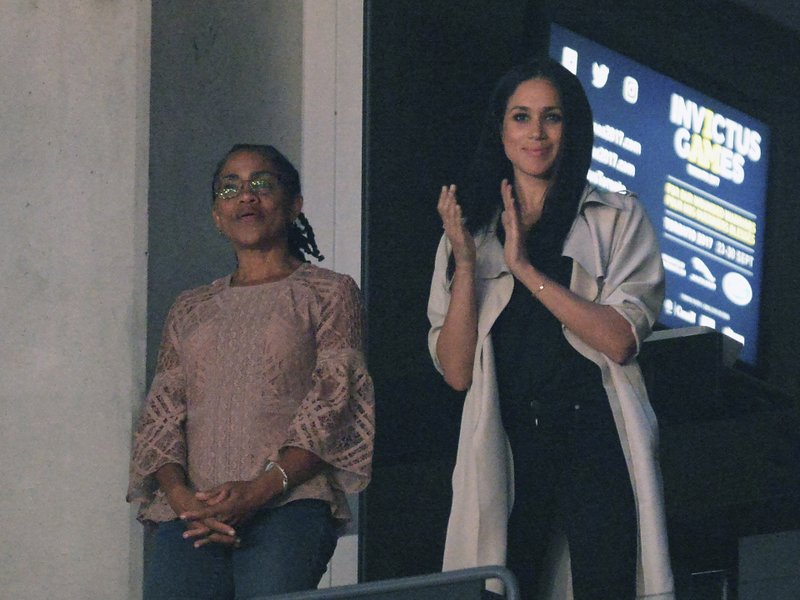 File - In this photo, Meghan Markle, right, watches the closing ceremonies of the Invictus Games with her mother Doria Ragland in Toronto on Saturday, Sept. 30, 2017. Photo: AP