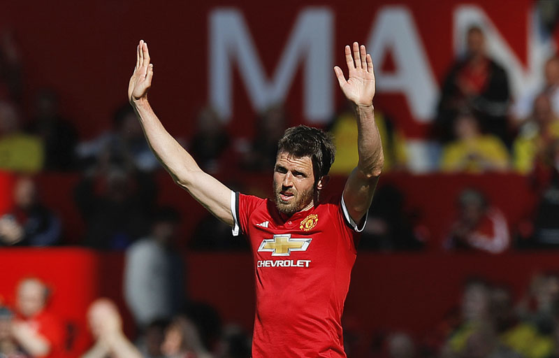 Manchester United's Michael Carrick salutes the fans as he leaves the field after his final playing appearance, during their English Premier League  match against Watford, at Old Trafford, Manchester, England, on Sunday, May 13, 2018. Phot: Associated Press.