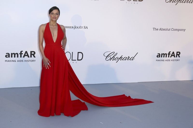 Actress Michelle Rodriguez poses for photographers upon arrival at the amfAR, Cinema Against AIDS, benefit at the Hotel du Cap-Eden-Roc, during the 71st international Cannes film festival, in Cap du2019Antibes, southern France, on Thursday, May 17, 2018. Photo: APn