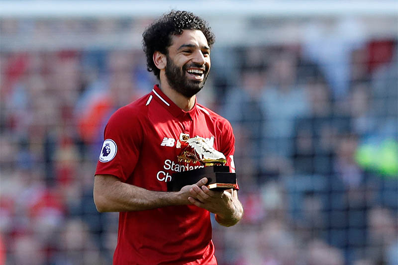 Liverpool's Mohamed Salah celebrates with the Golden Boot after the match. Photo: Reuters