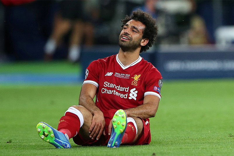 Liverpool's Mohamed Salah looks dejected after sustaining an injury. Photo: Reuters