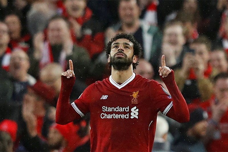 Liverpool's Mohamed Salah celebrates scoring their first goal. Photo: Reuters