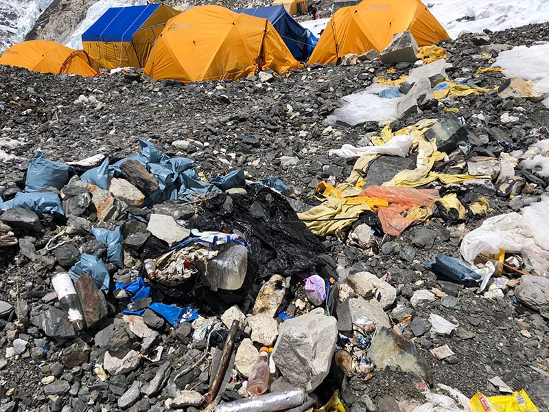 Bags full of human waste, tents and garbage left behind by climbers above Camp II on Mt Everest. Photo courtesy: David Liau00f1o