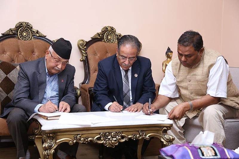 Two chairpersons of the Nepal Communist Party u2014 Prime Minister KP Sharma Oli (left) and Pushpa Kamal Dahal u2014 and Federal Socialist Forum-Nepal Chairman Upendra Yadav (right) sign two-point agreement, at the Prime Minister's official residence in Baluwatar, Kathmandu, on Monday, May 28, 2018. Photo: PM's Secretariat via RSS