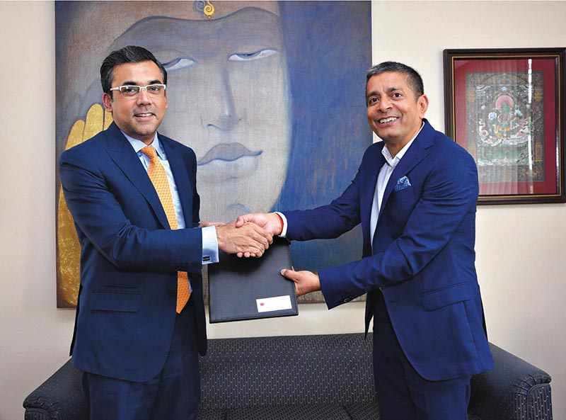 Jyoti Prakash pandey, CEO of NIBL, and Mohammad Rehan Rashid, resident representative, country head of IFC, shaking hands after signing an agreement, in Kathmandu. Photo Courtesy: NIBL
