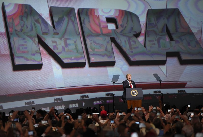 File - In this photo, President Donald Trump speaks during the National Rifle Association-ILA Leadership Forum, in Atlanta on April 28, 2017. Photo: AP