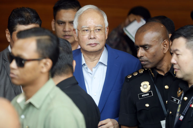 Former Malaysian Prime Minister Najib Razak, center, arrives at Anti-Corruption Agency for questioning, in Putrajaya, Malaysia, on Tuesday, May 22, 2018. Photo: Associated Press