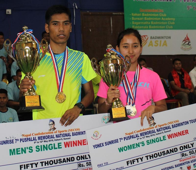 TACu0092s Ratnajit Tamang and Jessica Gurung of Jhapa hold the trophies after the seventh Pushpalal Memorial National Badminton Tournament in Itahari on Saturday, May 12, 2018. Photo: THT