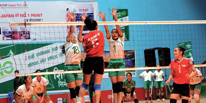 Action in the match between NDA and TAC (front) during the fourth KNP Japan National Women's Volleyball Tournament at the NSC covered hall in Kathmandu on Sunday. Photo: THT