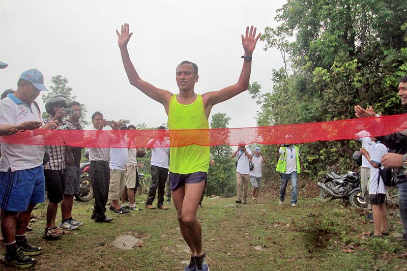 Nepali Army sergent Navaraj Saud touches finishing ribbon after winning first Byas Nagar Ultra Marathon held at Tanahun Byas Municipality, on Saturday, May 12, 2018. The race started from Manungkot to Pulimrayang in the district.
