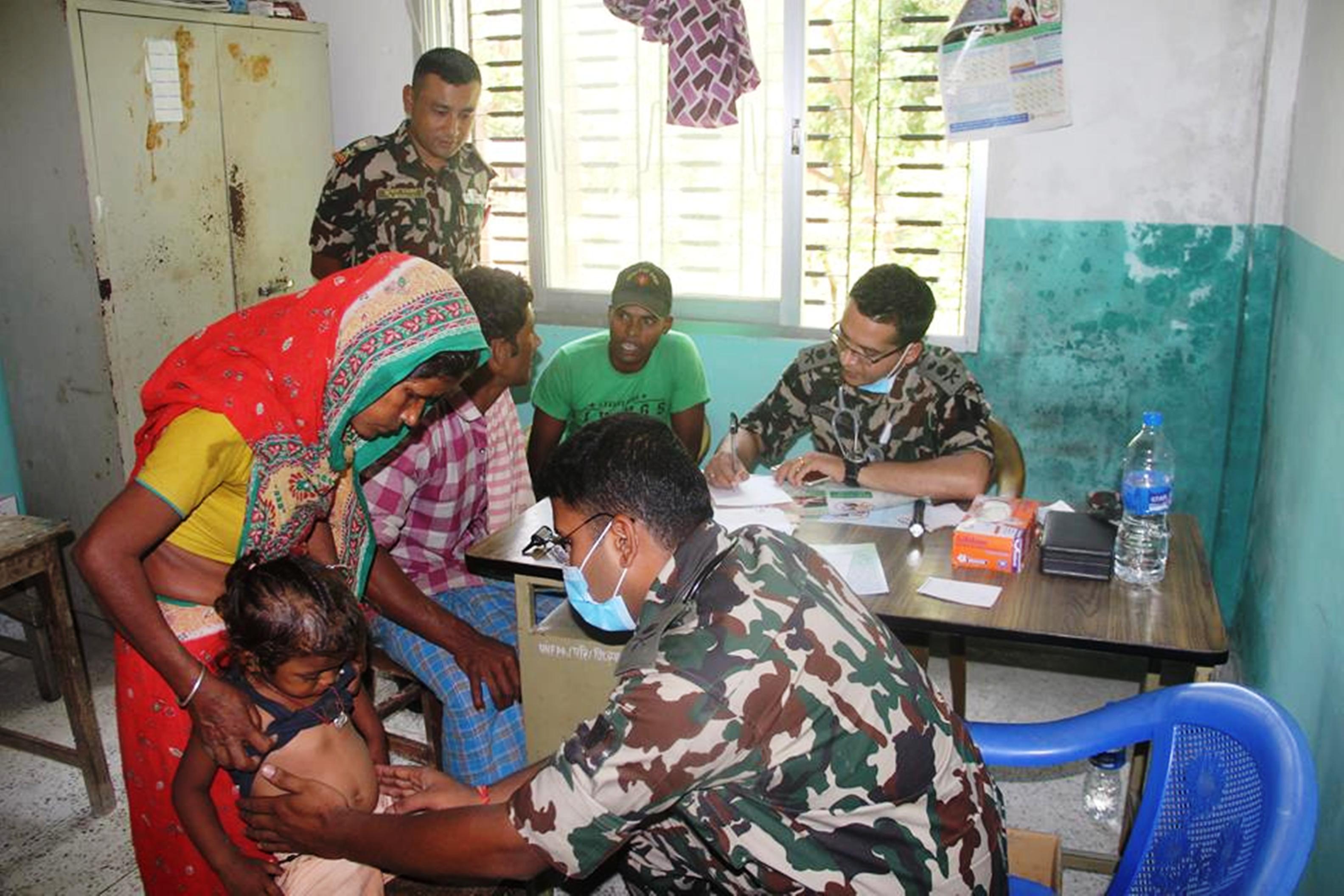 Doctors examining denizens of Dumriya in Ishanath Municipality, Rautahat at a free health camp ran by Nepal Armyu2019s Indra Box Battalion on Wednesday, May 9, 2018. Photo: Prabhat Kumar Jhan