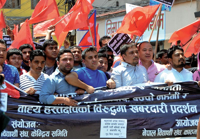 Members of Nepal Student Union staging a protest rally against recent price hike of petroleum products, in Kathmandu, on Friday, May 25. Photo: THT