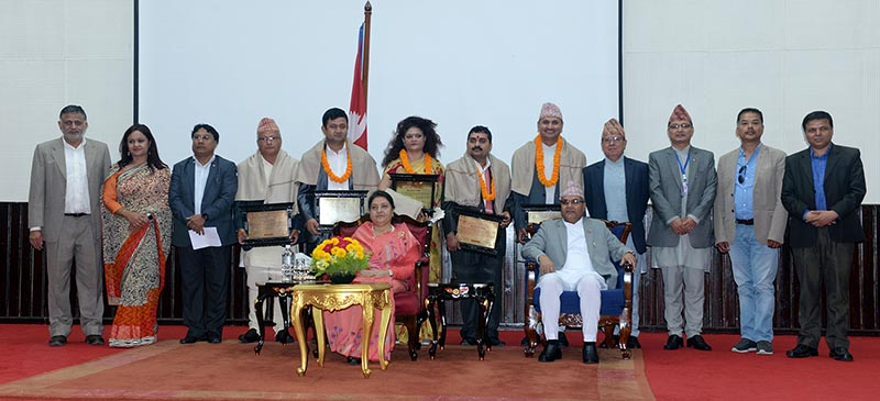 President Bidya Devi Bhandari posing for a group photo after honouring former president of Federation of Nepali Journalists Mahendra Bista and journalist Rajesh Ahiraj with the National Journalism Award, which was announced by the Ministry of  Communications and Information Technology, in Kathmandu, on Monday, May 7, 2018. Photo: THT