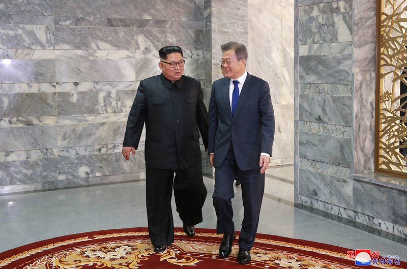In this photo provided by the North Korean government, North Korean leader Kim Jong Un, left, and South Korean President Moon Jae-in, right, walk together to their meeting at the northern side of Panmunjom in North Korea on  May 26, 2018. Photo: AP