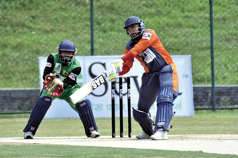 Nepal APF Clubu2019s Pradeep Singh Airee plays a shot against Province4 during their PM Cup match in Kathmandu on Sunday. Photo: THT