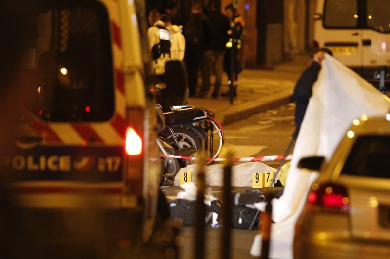 A dead body lays under a blanket after a knife attack Saturday that left at least two dead including the assailant in central Paris, on early Sunday May 13, 2018. Photo: AP