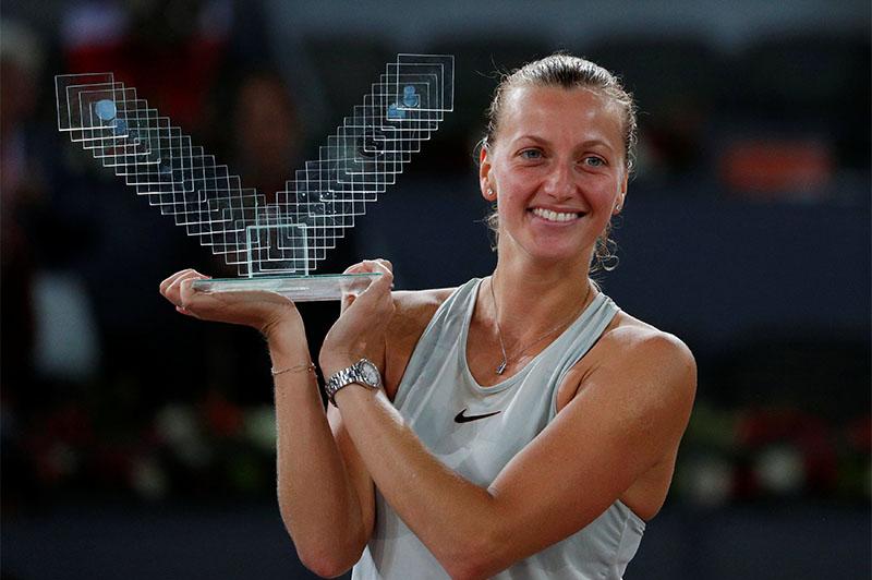 Czech Republic's Petra Kvitova celebrates with the trophy after winning the final against Netherlands' Kiki Bertens. Photo: Reuters
