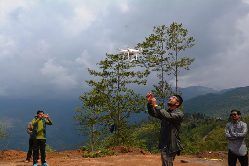 Technicians using drone technology while conducting survey as part of a feasibility study for airport construction, in Ranitar, Phidim Municipality, Panchthar, on Saturday, May 5, 2018. Photo: Laxmi Gautam