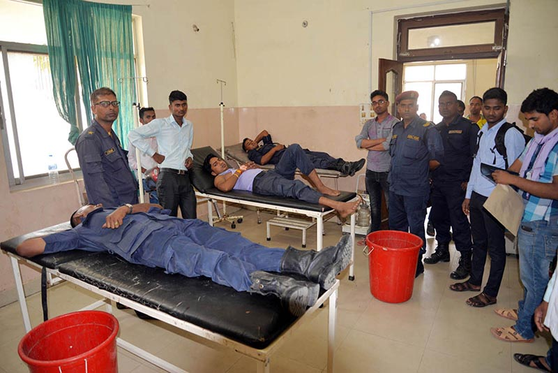 Policemen injured in attack carried out by pickets demanding the release of arrestees, undergoing treatment at Birgunj-based Narayani Sub Regional Hospital, Parsa district, on Monday, May 7, 2018. Photo: RSS