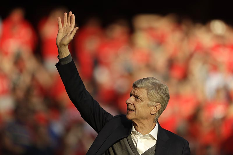 Arsenal's French manager Arsene Wenger waves to spectators during a lap of honor after the match between Arsenal and Burnley at the Emirates Stadium in London, on Sunday, May 6, 2018. Photo: AP