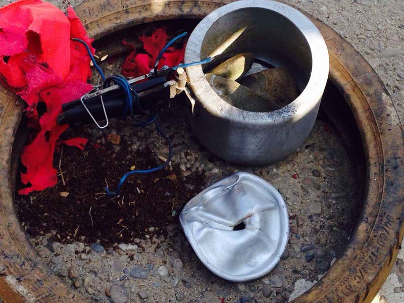 This image shows the defused pressure cooker bomb kept on a road in Dhurabazaar of Kamalamai Municipality in Sindhuli district, on Saturday, May 5, 2018. Photo: Min Kumar Dahal
